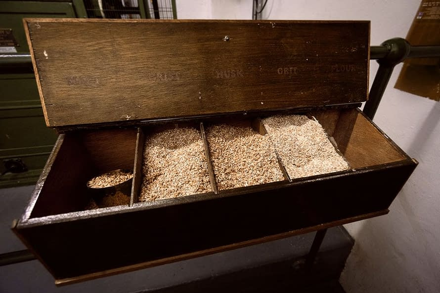 Malt Samples at Ardbeg Distillery - five bins showing, from left to right: whole grains of malted barley, grist, husk, grit and flour (not visible).