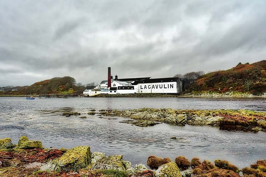 autumn toned photograph of Lagavulin distillery viewed from Dunyvaig Castle