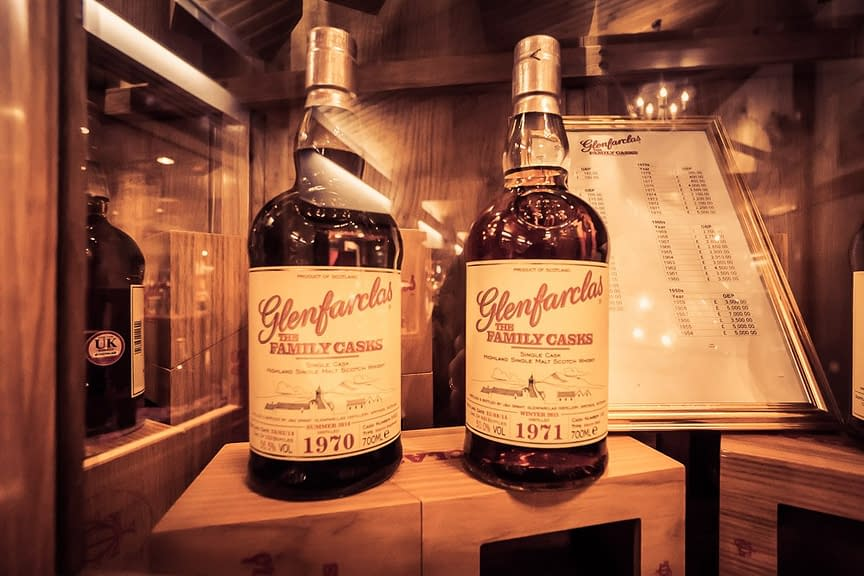 Photograph of bottles of the 1970 and 1971 Glenfarclas Family Cask Editions on display in the Glenfarclas Distillery Visitor Centre.