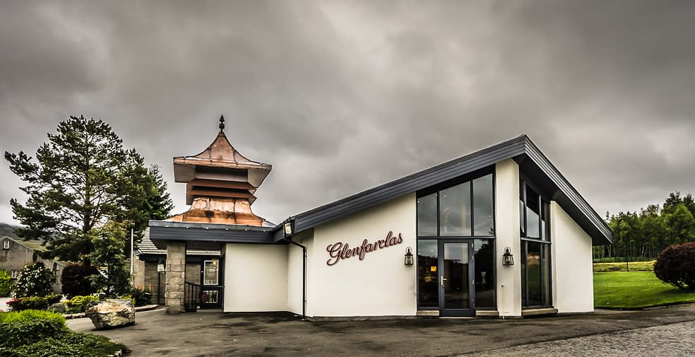 Colour photograph of the Glenfarclas Distillery Visitor Centre, complete with pagoda chimney.