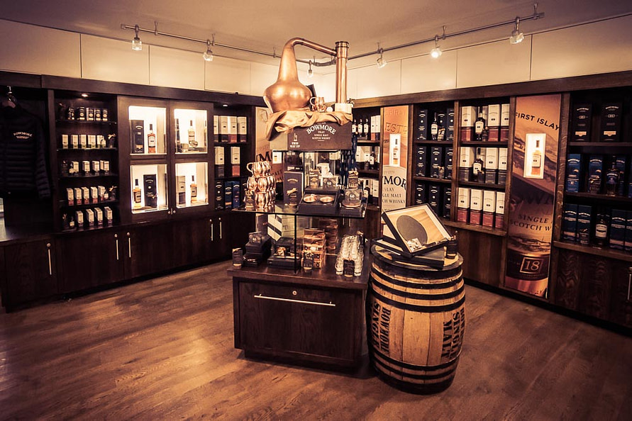 Whisky and whisky-related merchandise available to purchase inside the gift shop at Bowmore Distillery.