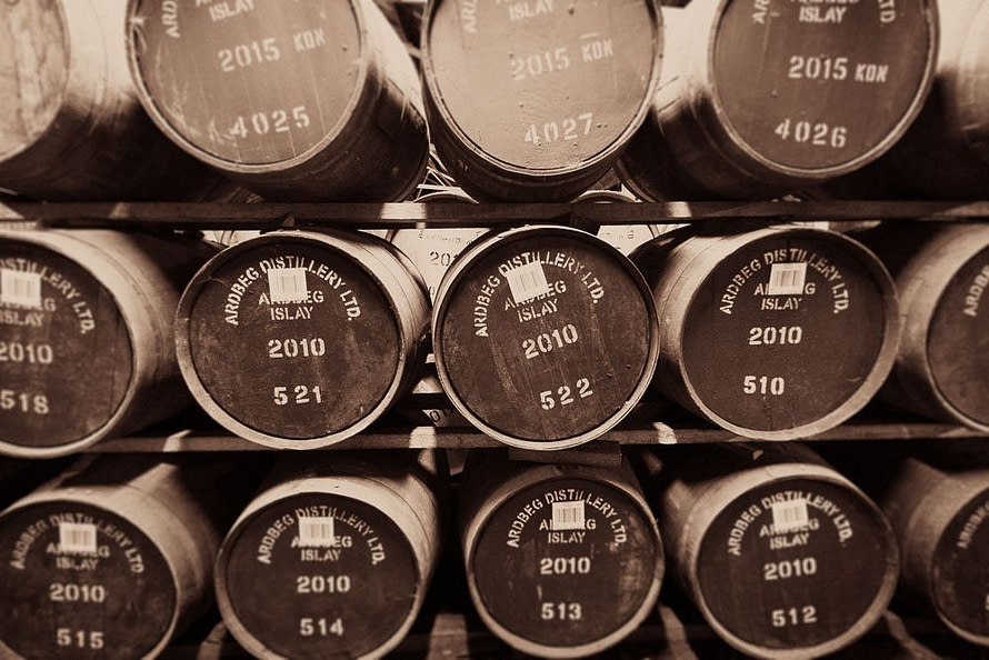 Sepia toned photograph of Ardbeg 2010 Casks on 3 racks. Ardbeg has only five warehouses at present (2019) - 2 dunnage warehouses and 3 racked, holding a total of 25,000 barrels. Ardbeg is in the process of expanding their warehousing capacity so more of their spirit can be matured on Islay.