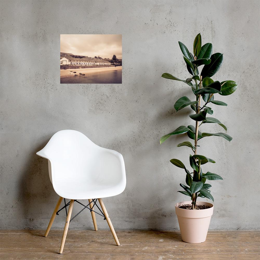 Luster photo paper poster of Bunnahabhain Distillery on a grey wall behind a white chair