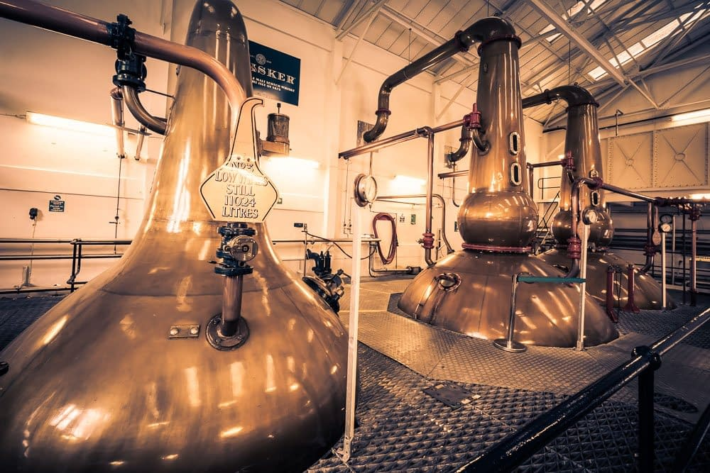 Copper tinted photo of Talisker Distillery wash stills and one of the low wines stills