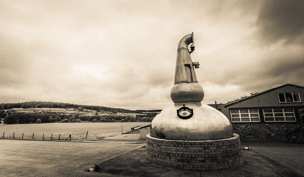 My favourite kind of garden ornament: an old still at the entrance to Glenfarclas Distillery.