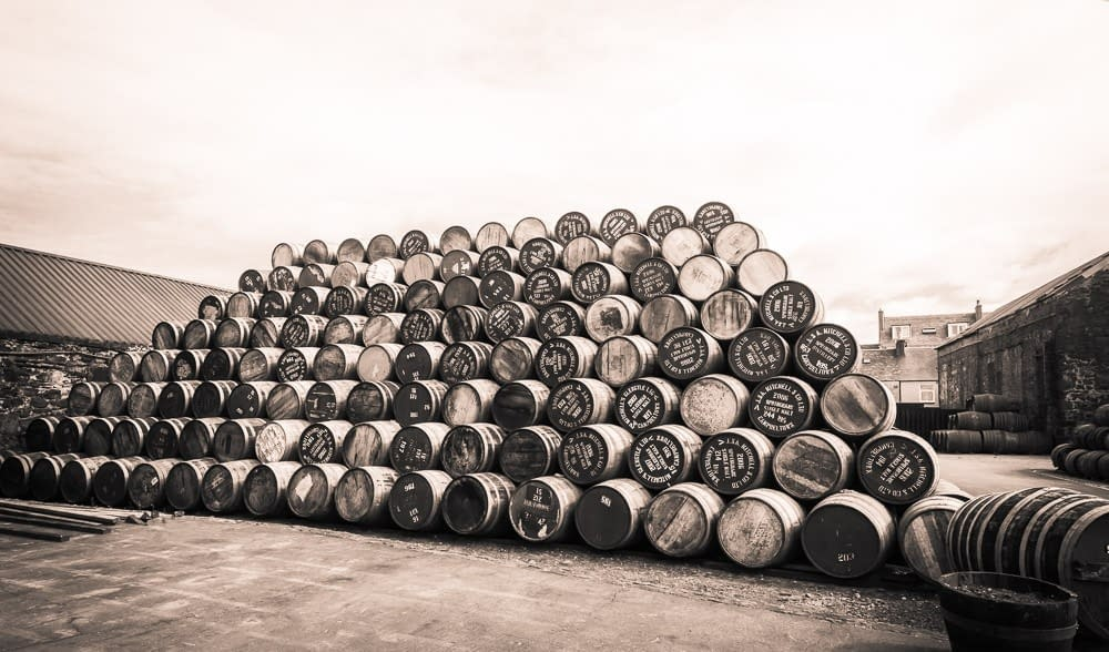 Empty Glengyle and Springbank Casks in the yard at Springbank Distillery