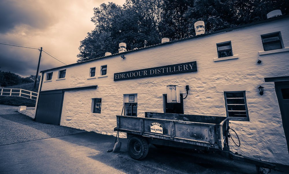 Edradour Distillery Still House - the draff is shovelled from the Mash Tun into the trailer, then taken off to a neighbouring farm and fed to cattle.