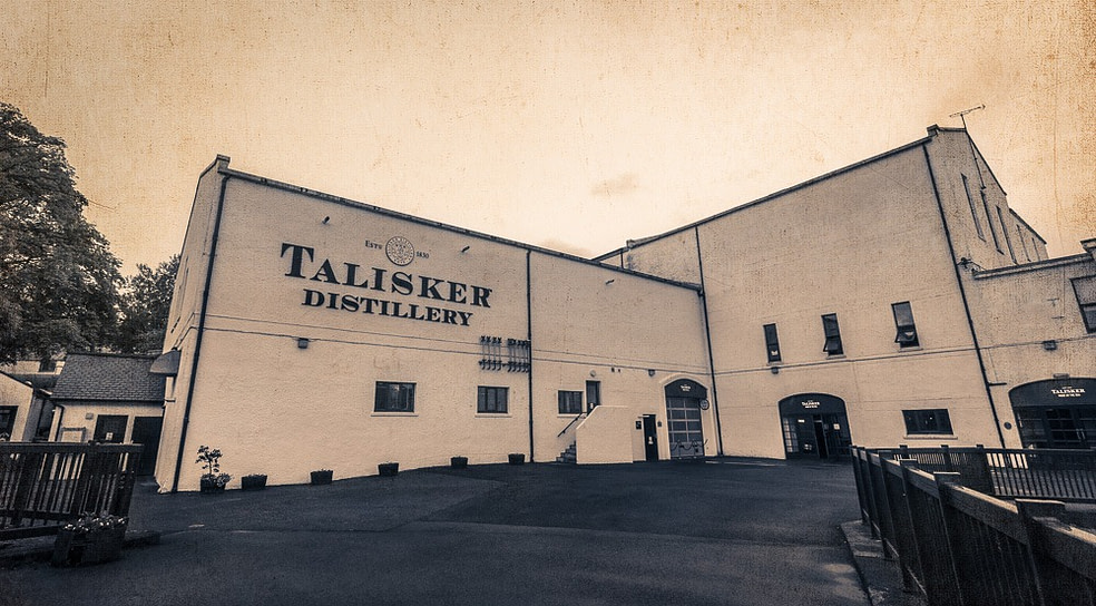 Black and white vintage worn paper style wide angle photograph of Talisker Distillery main building including talisker distillery logo