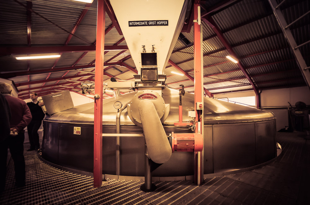 The steel lauter-style mash tun and intermediate grist hopper at Glenfarclas Distillery - 10 metres in diameter and 16.5-tonne capacity.