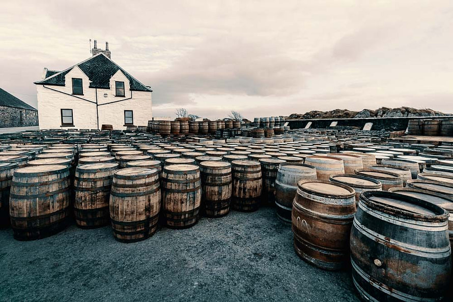 Empty casks waiting to be filled, in the yard at Ardbeg Distillery. The majority of Ardbeg whisky matures in ex-Bourbon oak.