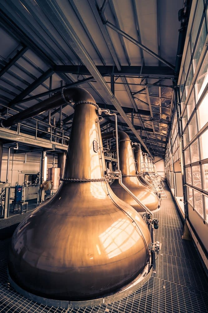 A squadron of stills at Glen Ord Distillery. Seven of eight in this picture