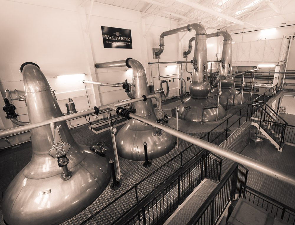 Black and white photo of Talisker Distillery wash and spirit stills