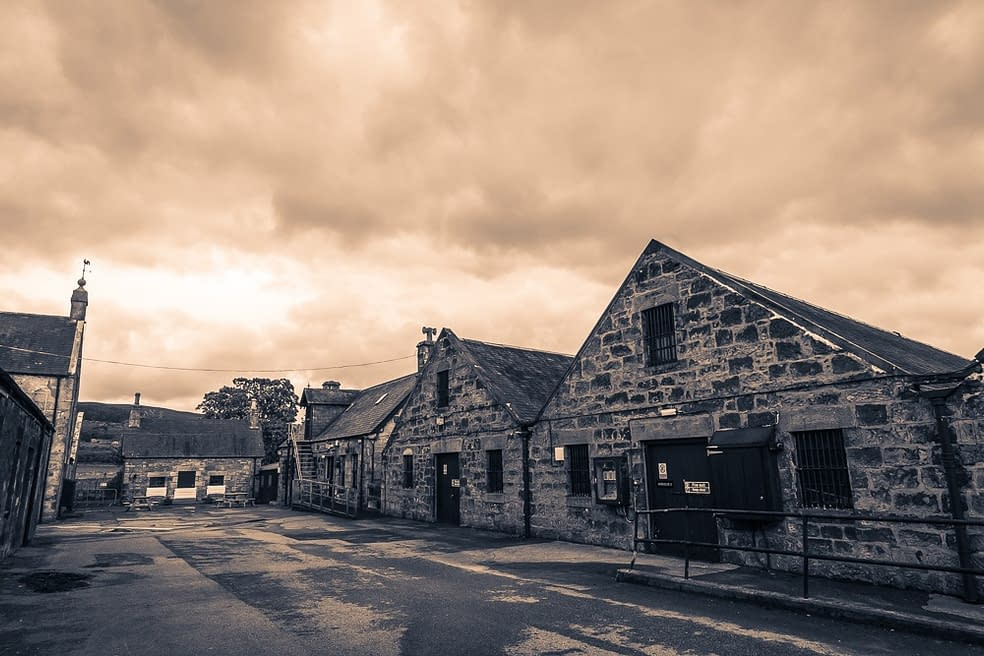 Warm toned black and white image of Clynelish Brora distillery warehouses
