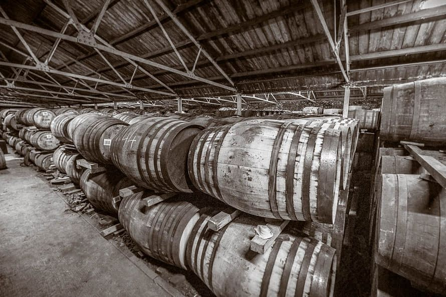 Black and white photograph of Casks in the warehouse at Ardbeg Distillery.