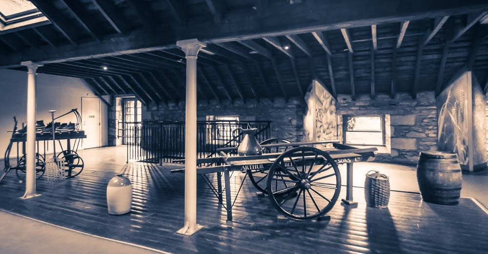 The tun room at Blair Athol Distillery contains several pieces of historic equipment