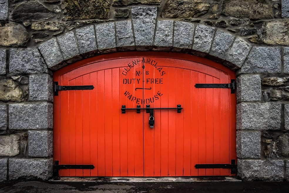 Colour photograph of the red Glenfarclas Distillery Duty Free Warehouse No.6 Door